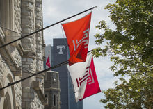 Temple Flags hanging off a building.