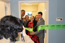 Ribbon being cut at the Small Business Development Center