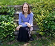 Amy Freestone sitting in the garden at the Temple Ambler Field Station